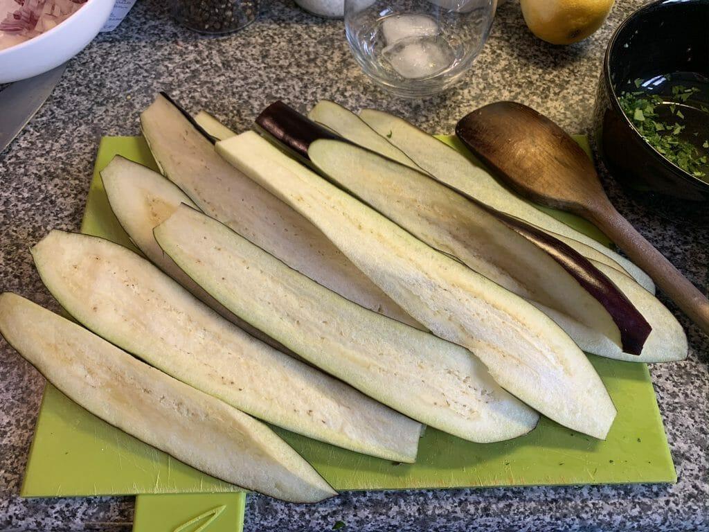 Sliced aubergines on a chopping board
