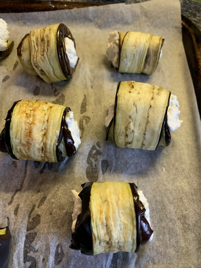 Aubergine rolls with the ricotta filling ready to go into the oven