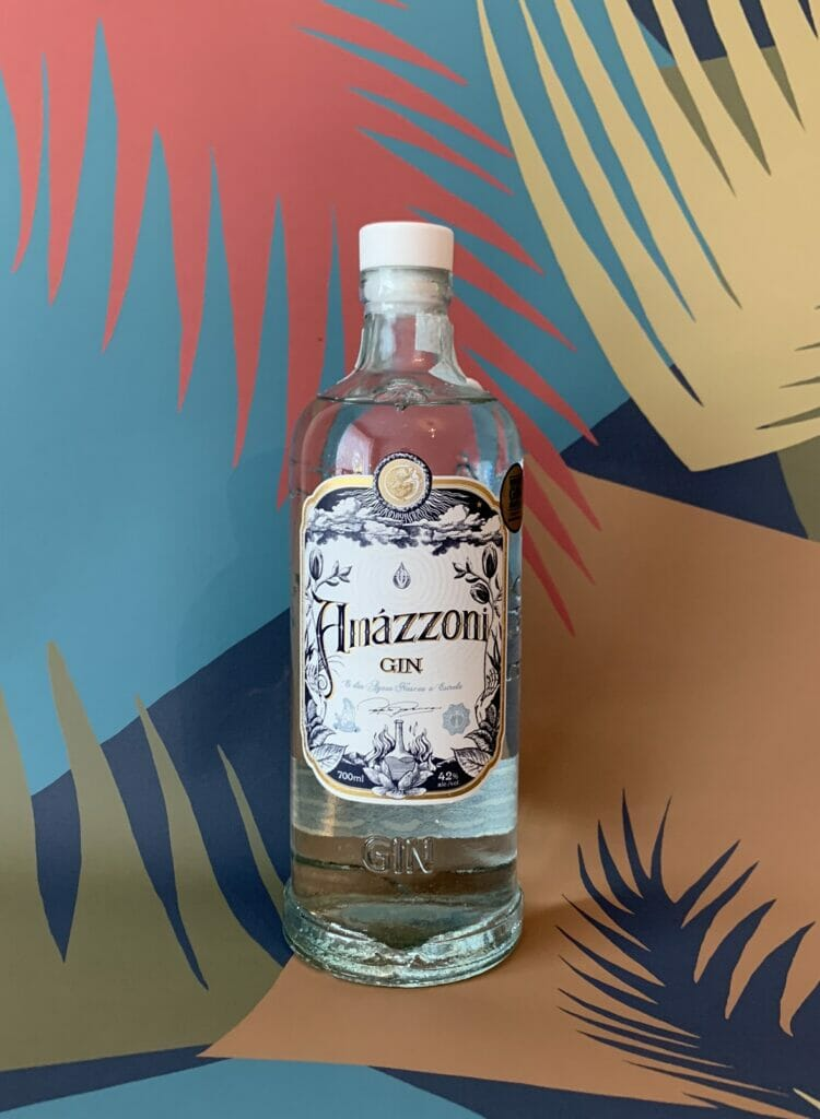 Amazzoni bottle in front of frond print