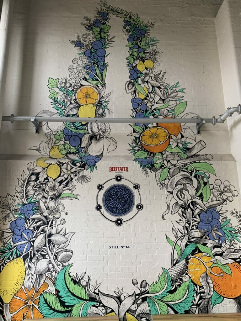 'Still number 14' a mural painted onto the wall surrounded by botanicals
