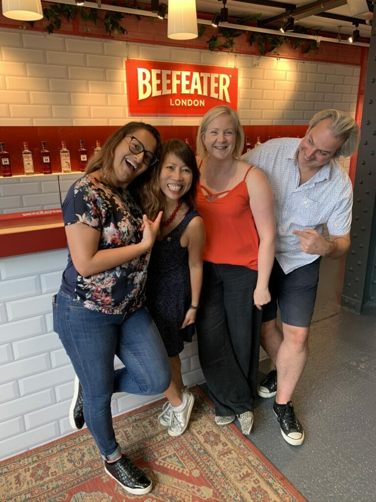Katie and her gin friends in front of the Beefeater gin bar at the distillery