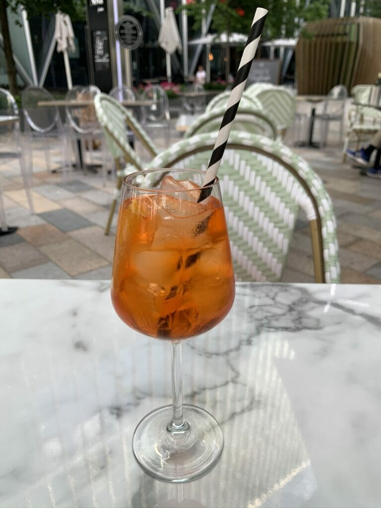 Aperol spritz outside on a restaurant table