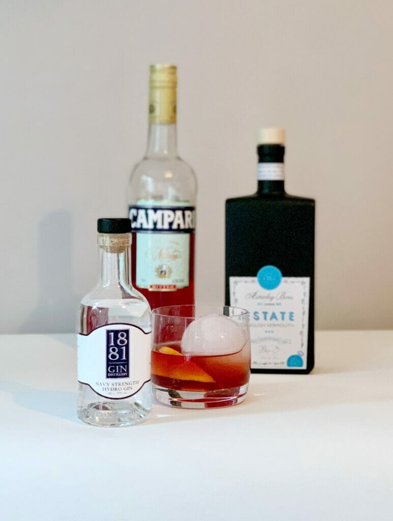 1881 Navy Strength negroni with ingredient bottles