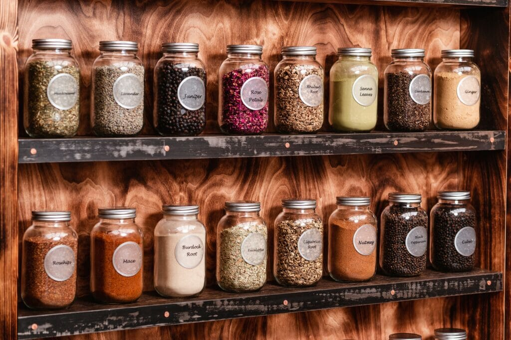 Shelves with jars of the botanicals you can use at 1881 distillery gin school