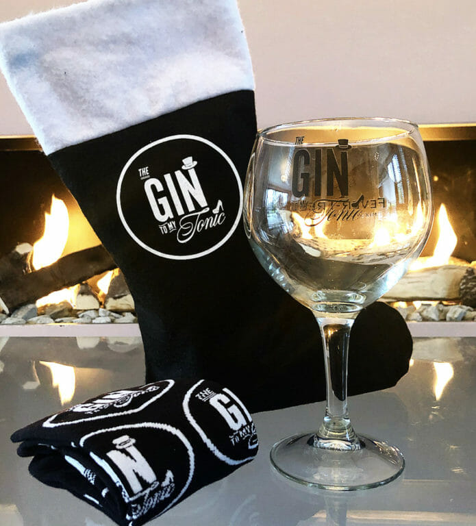 The Gin to My Tonic branded stocking with socks and copa gin glass