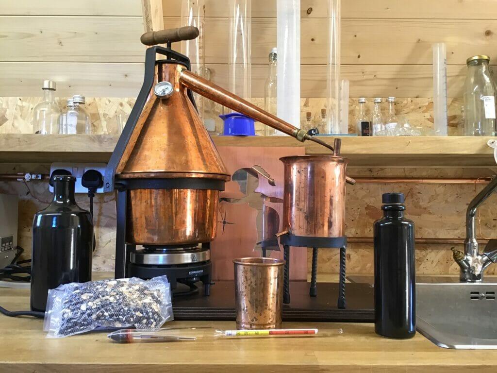 A mini copper still on the counter top