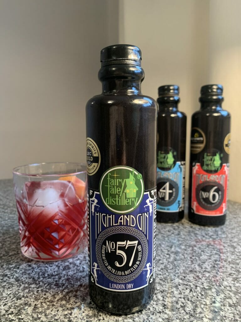 No. 57 Highland gin negroni with the other gin bottles in the background