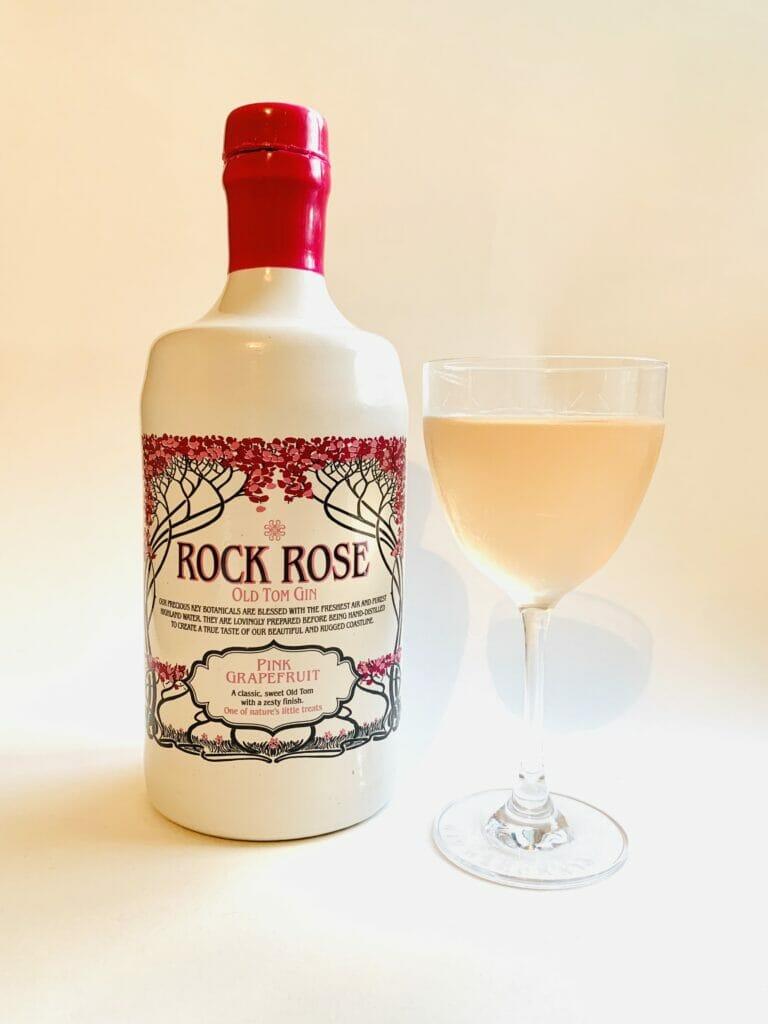 Rock Rose pink grapefruit Old Tom gin bottle and pink cocktail