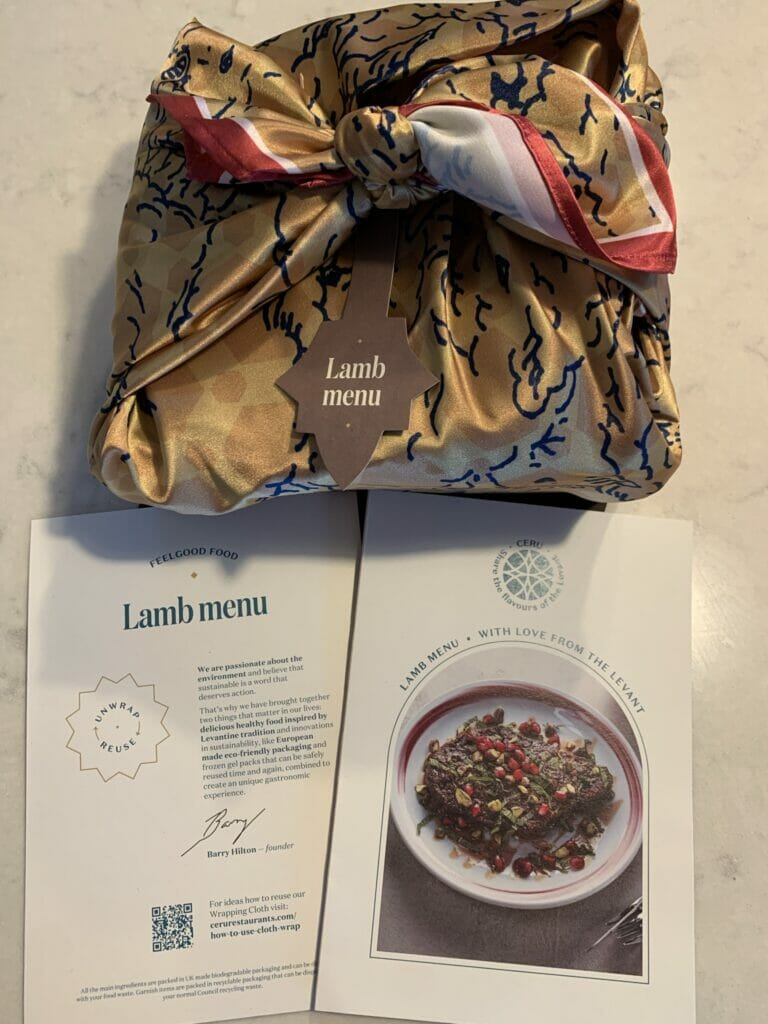 Lamb box wrapped in printed scarf with instructions