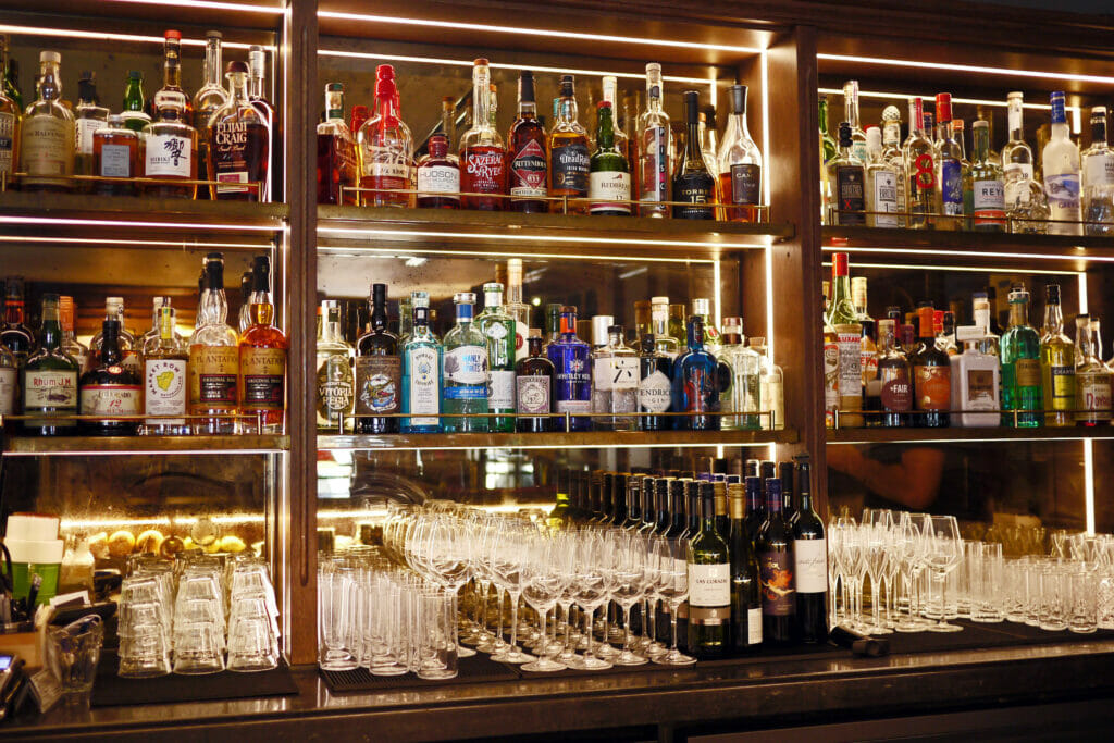 Backbar at Hensons in Soho with spirits and glasses on display